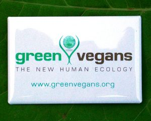 This Green Vegans logo is printed on the front tee-shirt pocket area and on the back, in large print, across the shoulders. 100% organic cotton, made in the U.S.